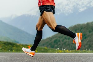legs men runner in black compression socks
