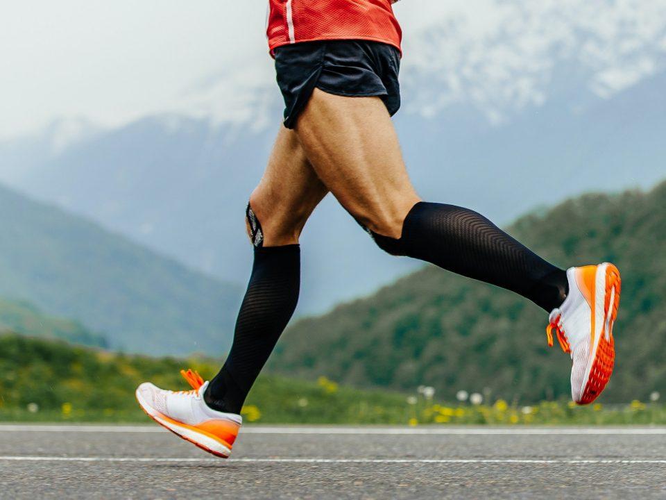 legs men runner in black compression socks